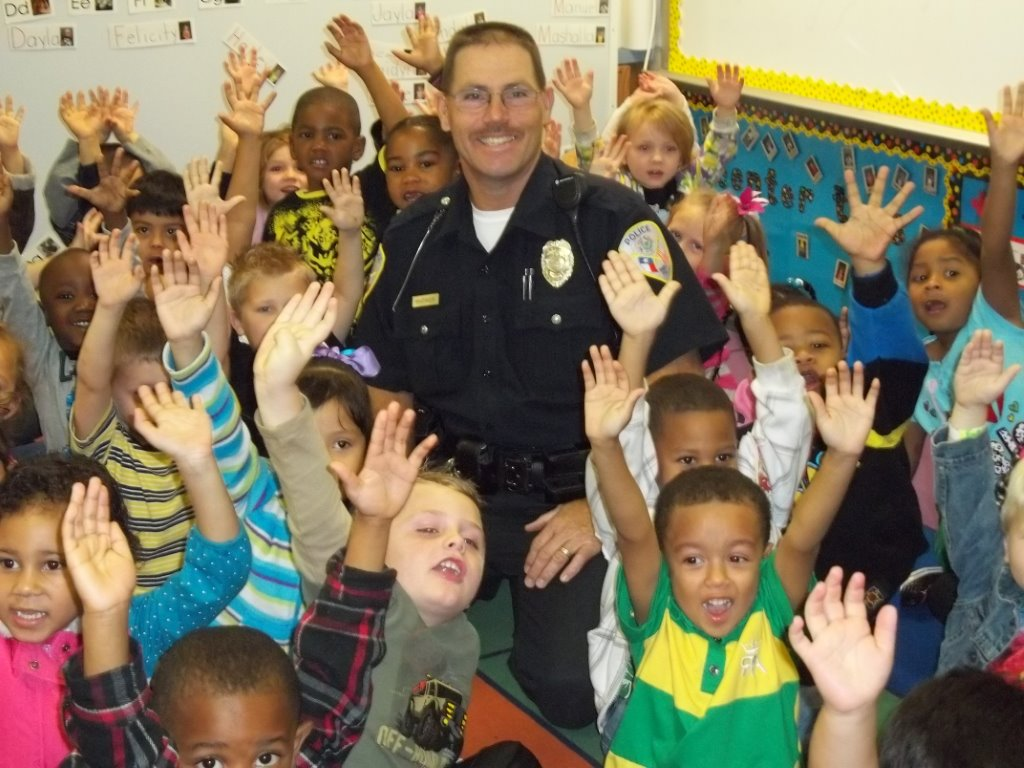 Officer David Whitaker Surrounded by Schoolchildren