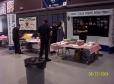 Officers setting up a presentation table